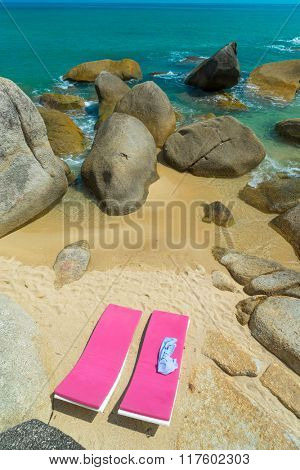 Lounge chair on the private  beach