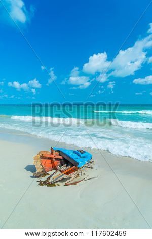 old boat wreck abandoned in the sand.