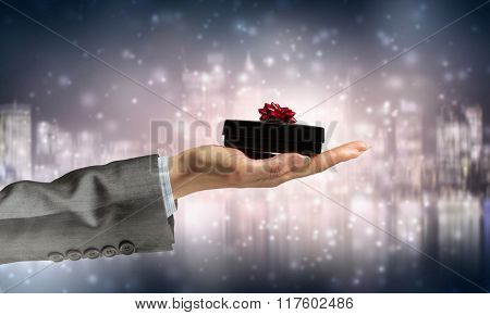 Man presenting his gift
