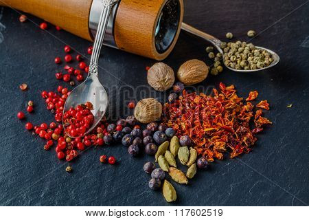 Spice And Pepper Grinder On Slatr Background