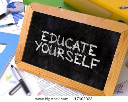 Educate Yourself Handwritten by White Chalk on a Blackboard.