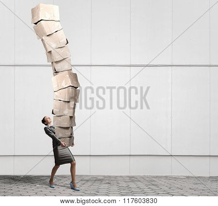 Woman carrying carton boxes