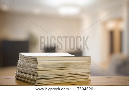 stack of old magazines on wooden table in the living room