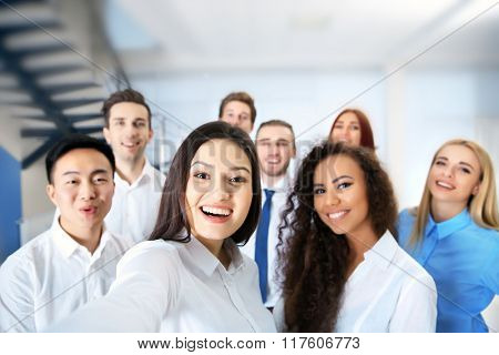Young people making photo of their self in office
