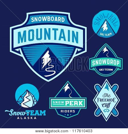 Set of Ski Snowboard Snow Mountains Sport Logos or Vintage Labels, Colorful on Blue Background