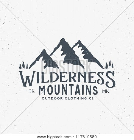 Wilderness Mountains Outdoor Clothing Vintage Vector Sign, Label or Logo Template. With Shabby Textu