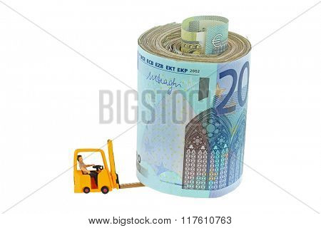 A miniature man sitting in a yellow forklift truck lifting a roll of money, isolated on white