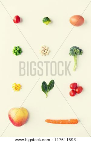 healthy eating, vegetarian food, diet and culinary concept - close up of ripe vegetables and food over white