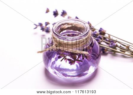 Aromatherapy oil and lavender, spa,  on a wooden background