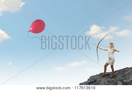 Woman aiming her goal