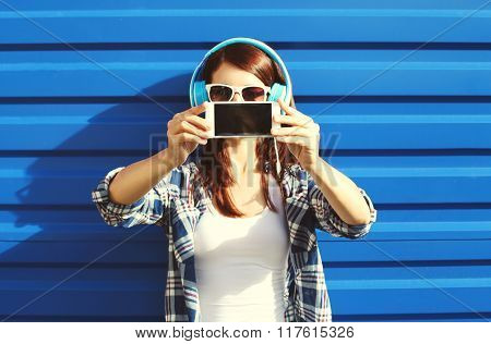 Girl Makes Self-portrait On Smartphone And Listens To Music In Headphones, Screen Phone Closeup
