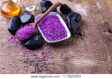 Spa setting. Lavender sea salt bottles with aroma oil