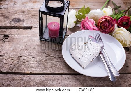 Decorative White  Heart, Knife And Fork On White Plate On Vintage Wooden Background.