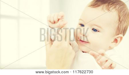 child, happiness and people concept - adorable baby boy