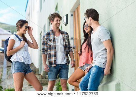 Hip friends talking on the street