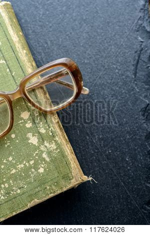 Book With Glasses On The Table