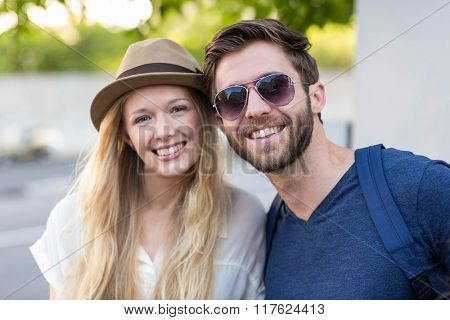 Hip couple posing for camera in the street