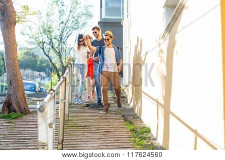 Hip friends going on a walk in the streets