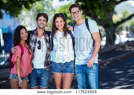 Hip friends posing for camera in the streets