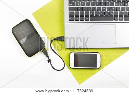 Laptop With External Hard Disk And Cell Phone