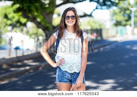 Hip girl posing for camera in the streets