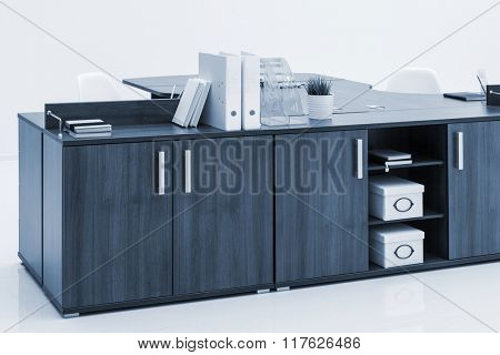 office desk and folder on a white wall