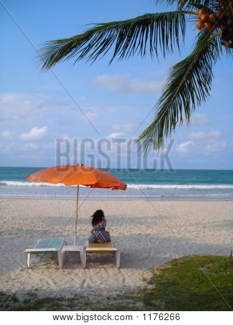 Woman Meditating At Beach At Bintan Indonesia
