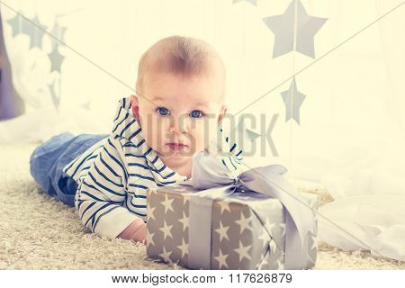 Portrait Of A Baby Boy In Front Of His Present In The Box