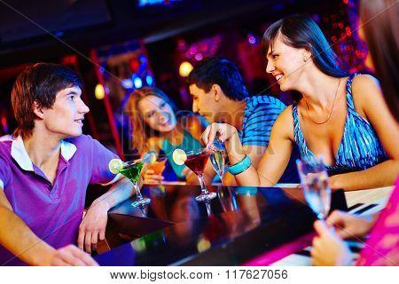 Talking at bar counter