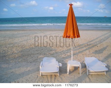 Two Deck Chairs At Beach At Bintan Indonesia