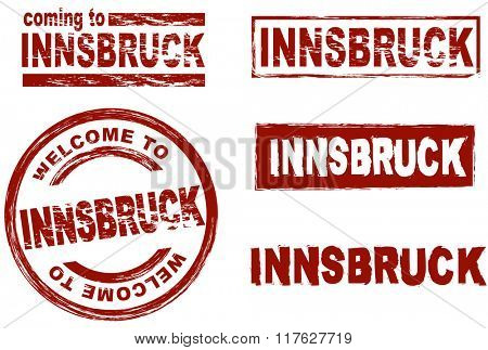 Set of stylized ink stamps showing the city of Innsbruck