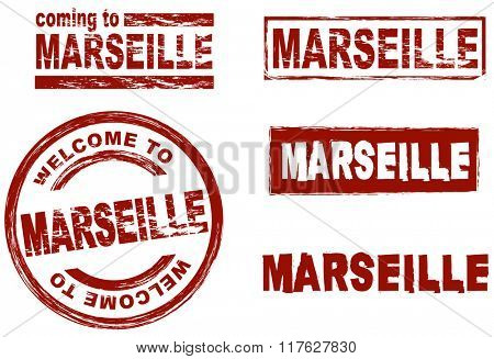 Set of stylized ink stamps showing the city of Marseille