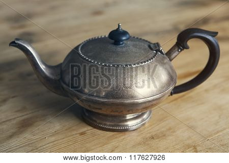 Old Antique Teapot On Wooden Table