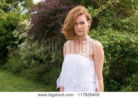 Beautiful ?aucasian woman in white dress