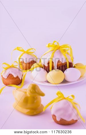 Decorated Easter Cakes And Eggs  In Yellow Colors. Selective Focus.