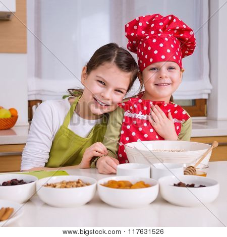 Happy Sisters Cooking Together