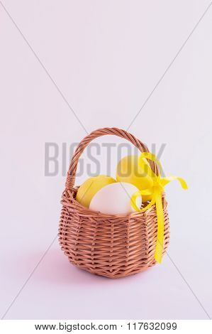 Easter Eggs In The Basket On A White Background. Selective Focus.