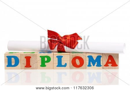 Diploma word formed by colorful wooden alphabet blocks, isolated on white background