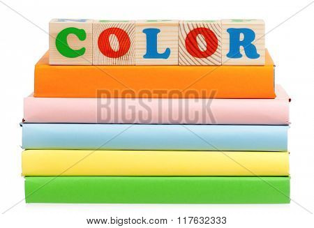 Color word formed by colorful wooden alphabet blocks, isolated on white background