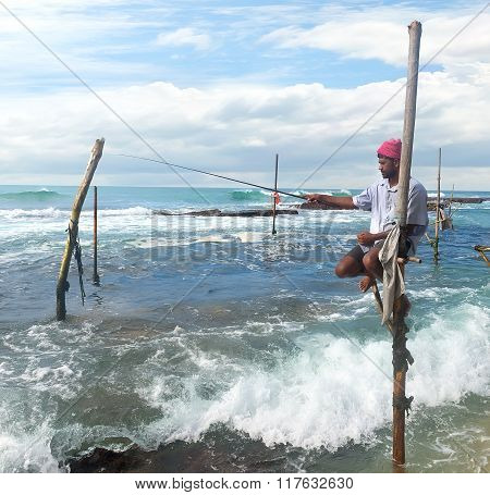 Fisherman on stick
