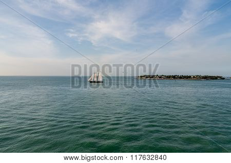 Two Masted Sailboat On Calm Bay