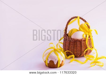 Easter Cake And Easter Eggs In The Basket On A White Background. Selective Focus.
