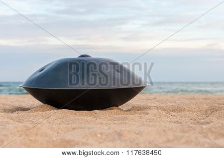 Close up of handpan or hang with sea and beach on Background. The Hang is traditional ethnic drum mu