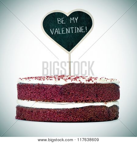 a red velvet cake topped with a heart-shaped chalkboard with the text be my valentine, with a vignette added
