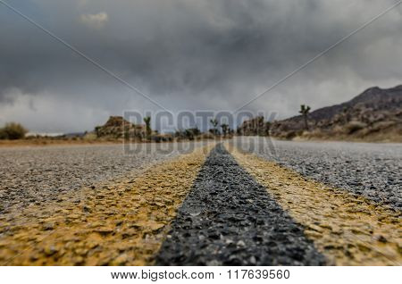 Extreme Low Angle Of Desert Road On Stormy Day