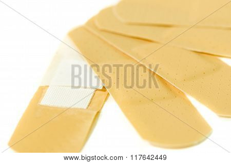 Many Adhesive Plasters Medicinal Patches Isolated On White