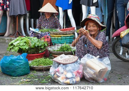 Old woman take a break for eat and rest at the market street