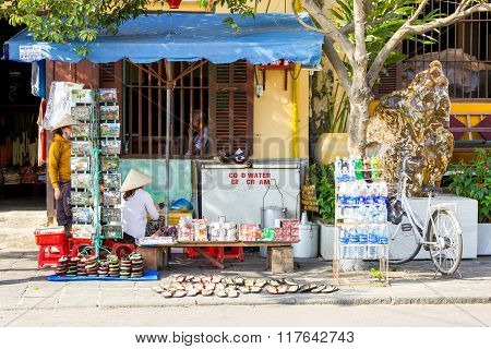 Women are selling things on the street of Hoi An ancient town