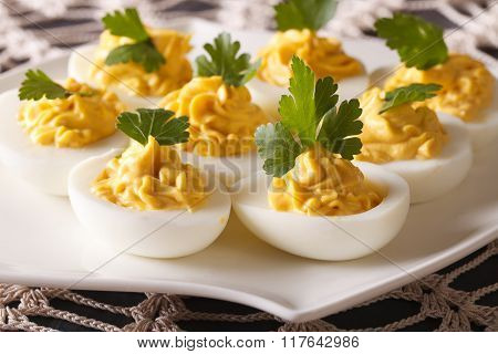 Stuffed Eggs With Mustard And Parsley Close-up. Horizontal