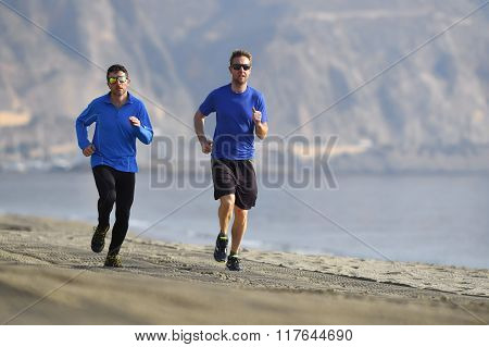 Two Men Friends Running Together On Beach Sand Coast Mountain Background Morning Training Session